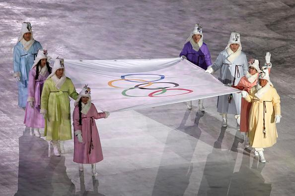 The Olympic flag is brought into the stadium during the Opening Ceremony. (Photo: Sean M. Haffey/Getty Images)