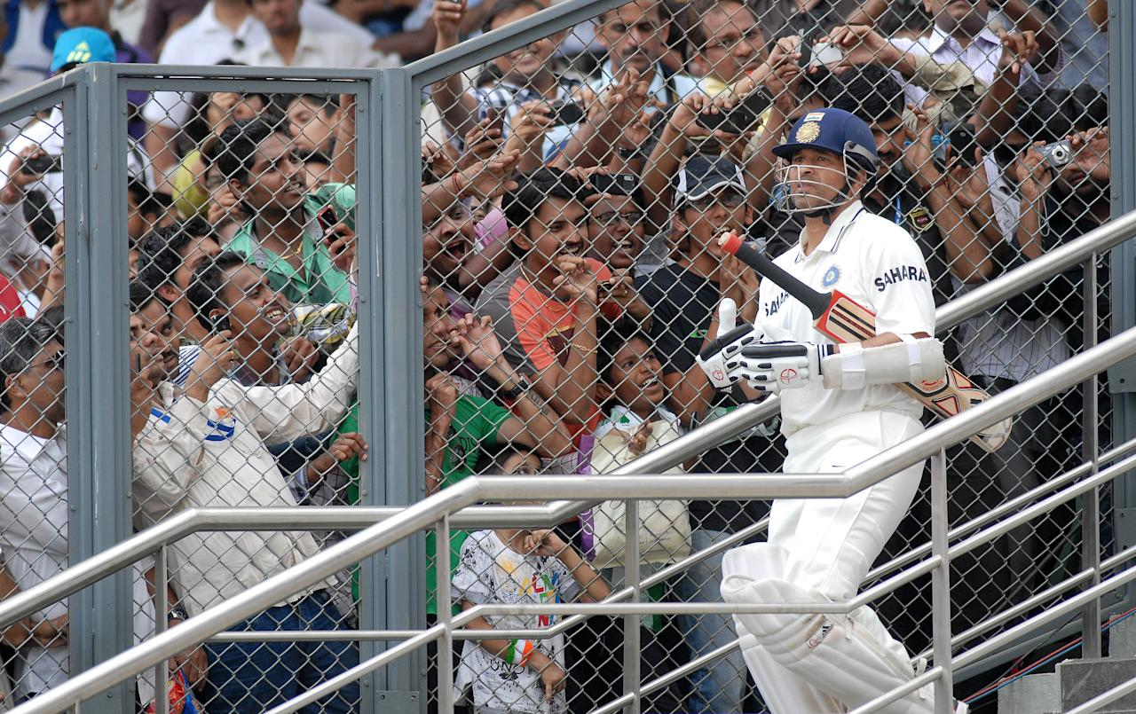 MUMBAI, INDIA ? NOVEMBER 24: Fans react as India's batting star Sachin Tendulkar arrives to bat during the third day of the third Test match against West Indies at the Wankhede Stadium in Mumbai on Thursday.(Photo by Mandar Deodhar/India Today Group/Getty Images)