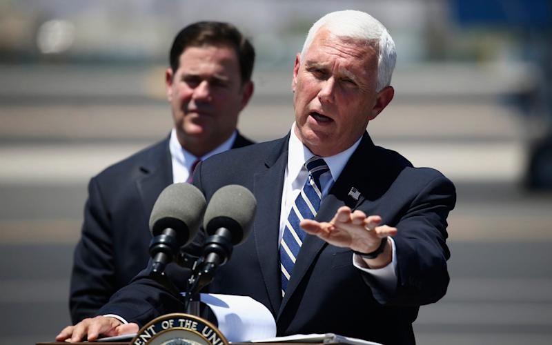 Mike Pence, speaking in Arizona yesterday, said a national order forcing people to wear masks was unnecessary - AP
