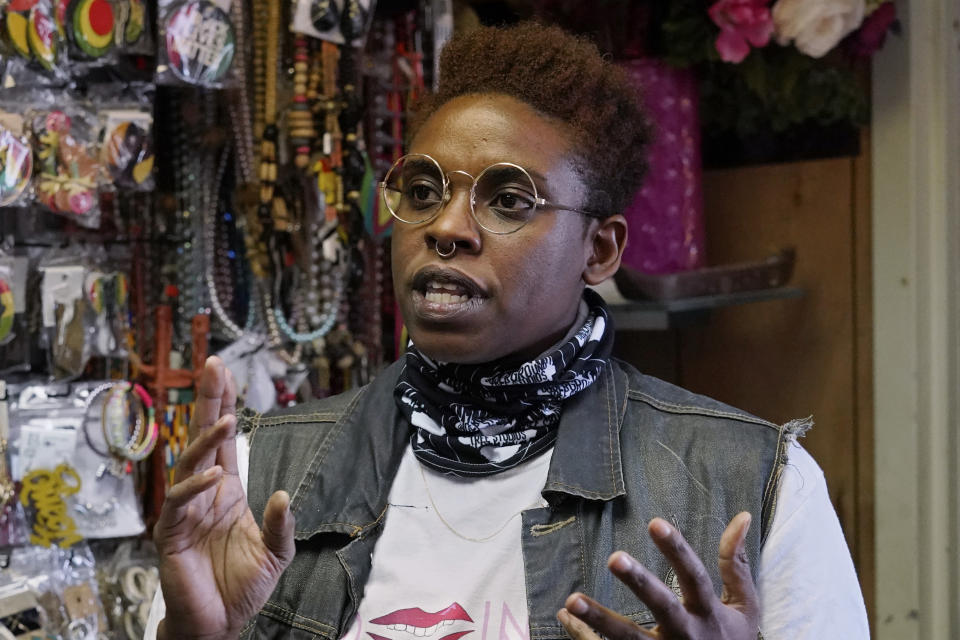 """Artist Dawn Tree speaks during an interview at the Black Wall Street Market in Tulsa, Okla., on Saturday, April 10, 2021. """"There's trauma that's blanketed over this city,"""" says Tree of 1921's Tulsa Race Massacre. """"Going forward, whatever is done to atone for what happened 100 years ago must be done for the north side community."""" (AP Photo/Sue Ogrocki)"""