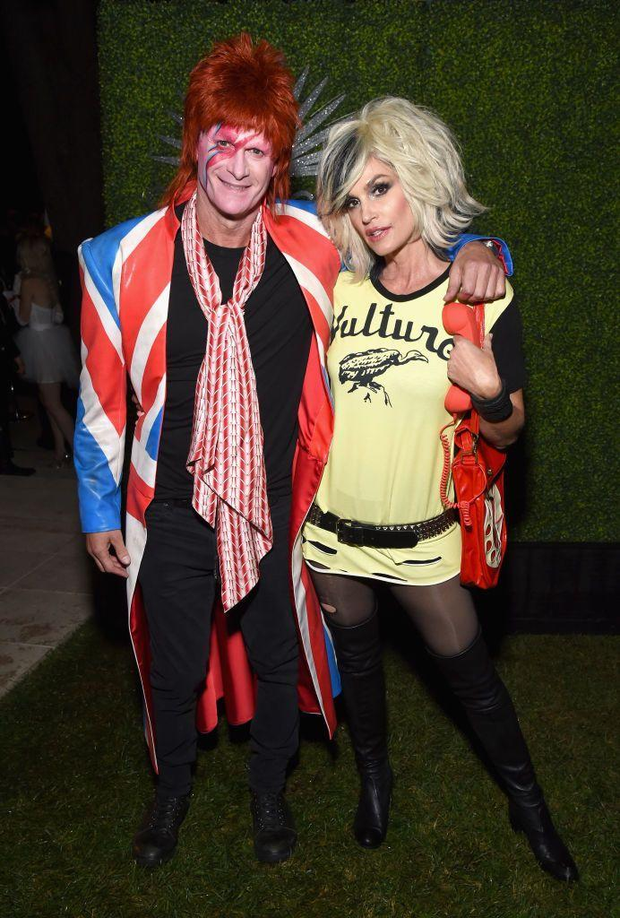 <p>At the <em>other </em>Casamigos H-ween party, spouses Rande Gerber and Cindy Crawford dressed as iconic rockers David Bowie and Blondie's Debbie Harry, respectively.</p>