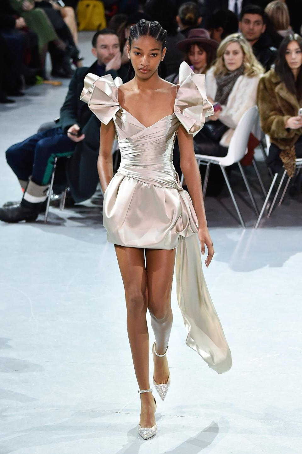 <p>Named a face to watch by <strong>Harper's Bazaar</strong> in 2018, Trinidadian model Naomi Chin Wing has taken her elegant strut across the catwalks of Dior, Givenchy, and Valentino since walking her very first show for Saint Laurent in 2017.</p>