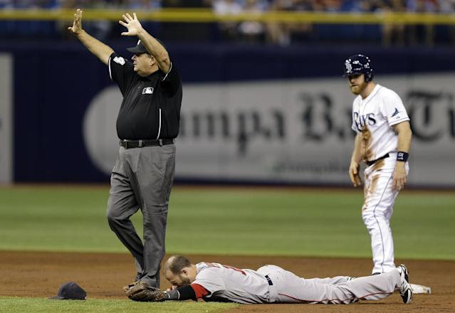 Second base umpire Jerry Layne calls for time as Boston Red Sox second baseman Dustin Pedroia is injured after colliding with Tampa Bay Rays' Logan Forsythe during the second inning of a baseball game Saturday, Aug. 30, 2014, in St. Petersburg, Fla. Pedroia left the game. (AP Photo/Chris O'Meara)