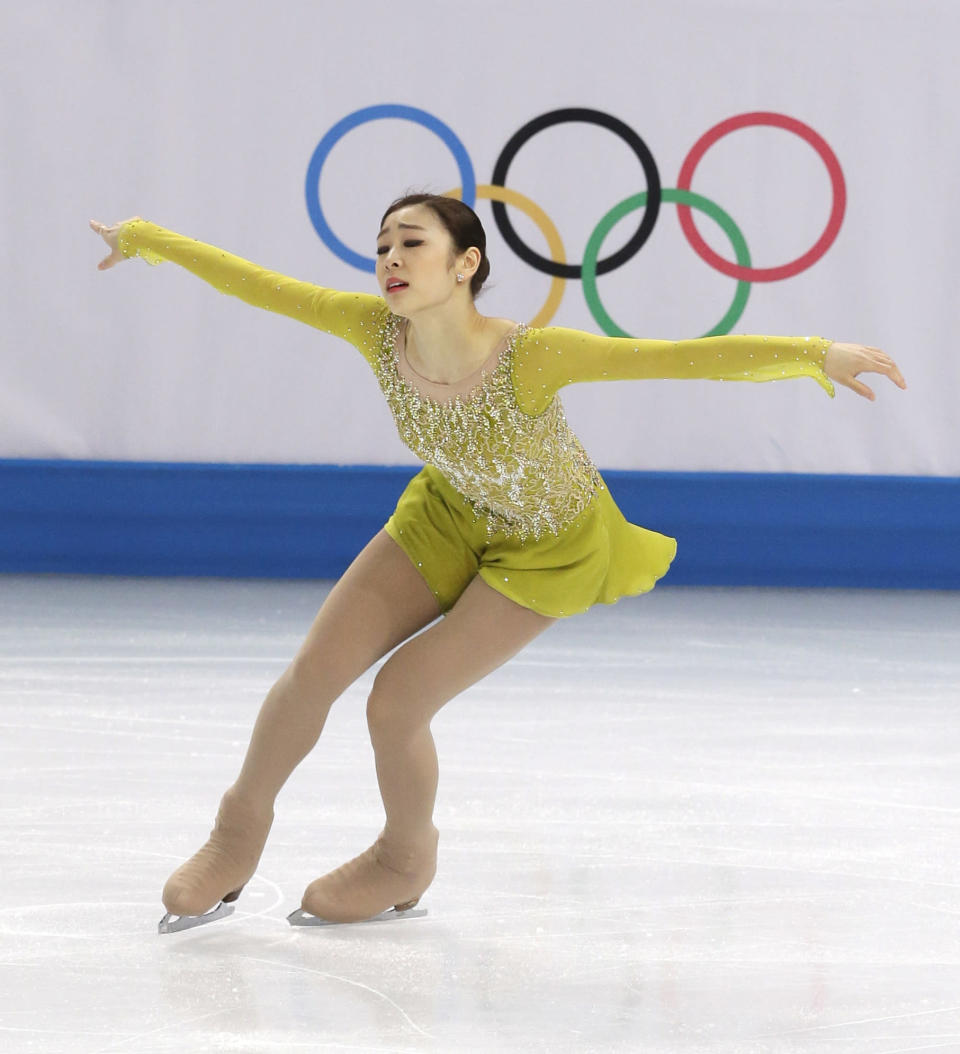 Yuna Kim of South Korea competes in the women's short program figure skating competition at the Iceberg Skating Palace during the 2014 Winter Olympics, Wednesday, Feb. 19, 2014, in Sochi, Russia. (AP Photo/Darron Cummings)