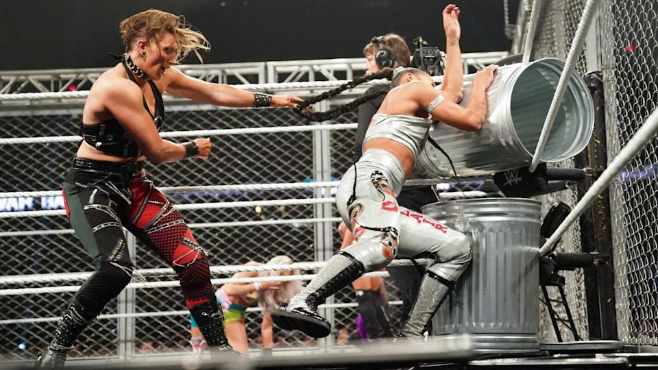 Rhea Ripley uses trash cans as weapons during a match at NXT TakeOver: WarGames 3. (Photo courtesy of WWE)