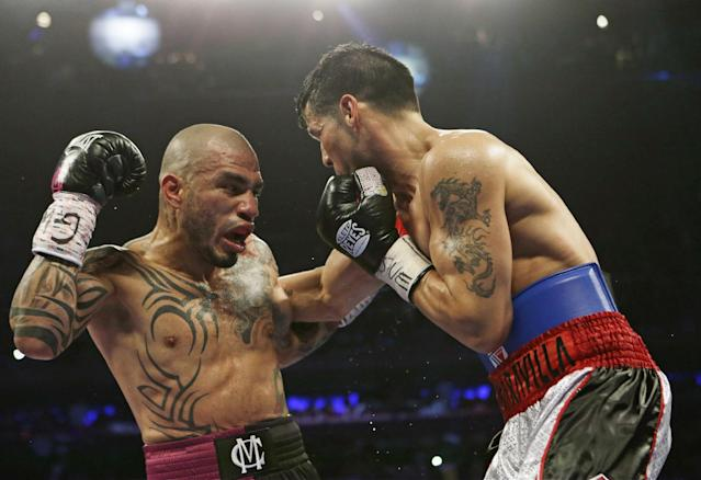 Miguel Cotto, of Puerto Rico, fights Sergio Martinez, of Argentina, during the first fourth round of a WBC World Middleweight Title boxing match Saturday, June 7, 2014, in New York. (AP Photo/Frank Franklin II)