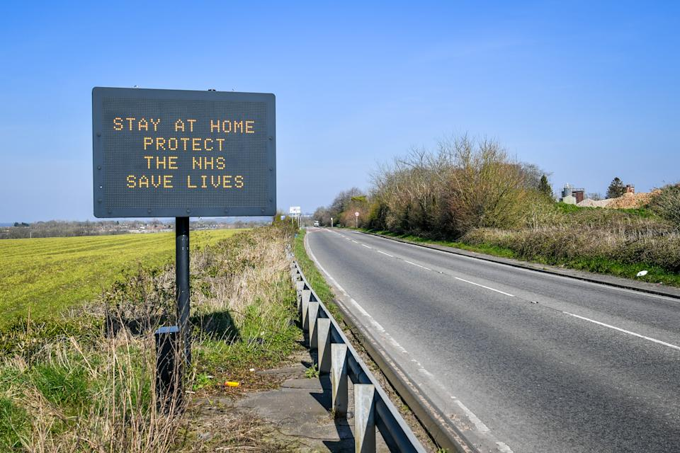 A matrix road sign on the A367 into Bath advises motorists to stay at home to protect the NHS and save lives the day after Prime Minister Boris Johnson put the UK in lockdown to help curb the spread of the coronavirus.
