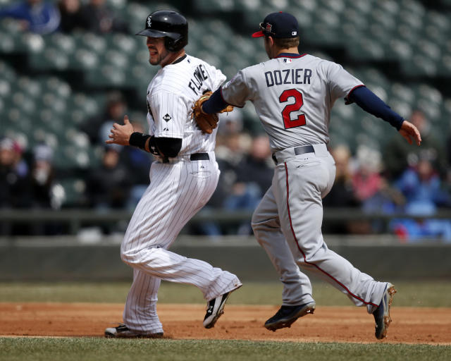 Chicago White Sox catcher Tyler Flowers is tagged out by Minnesota Twins second baseman Brian Dozier during the second inning of a baseball game on Wednesday, April 2, 2014, in Chicago, Ill. (AP Photo/Andrew A. Nelles)