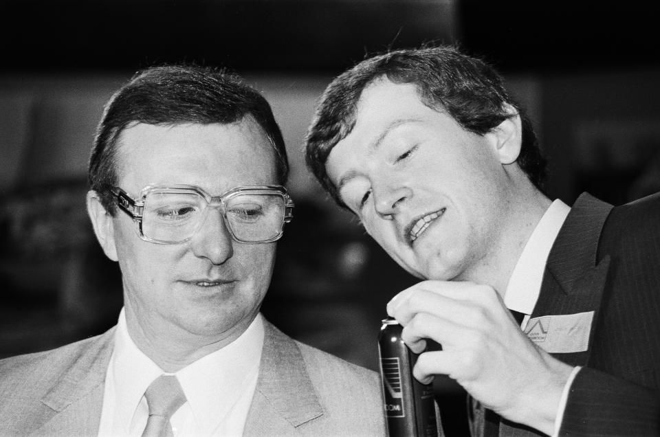 Snooker players Steve Davis and Dennis Taylor who recently contested the classic black ball World Championship Final in Sheffield, attend a press conference to promote the upcoming 1985 Matchroom trophy tournament. May 1985. (Photo by Allan Olley/Daily Mirror/MirrorpixGetty Images)