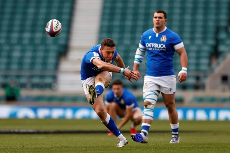 Best foot forward - Italy fly-half Paolo Garbisi (L) in action against England