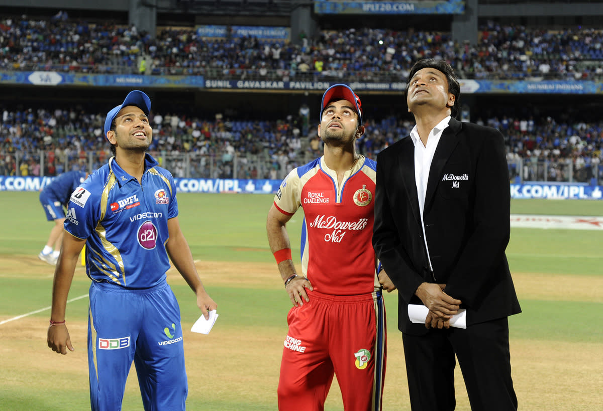 Rohit sharma of Mumbai Indians and Virat Kholi captain of Royal Challengers Bangalore during the toss  during match 37 of the Pepsi Indian Premier League ( IPL) 2013  between The Mumbai Indians and the Royal Challengers Bangalore held at the Wankhede Stadium in Mumbai on the 27th April 2013. (BCCI)