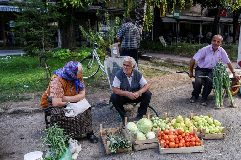Serb and Albanian street vendors sell fruit and vegetables by the side of the road in the southern Serbian town of Presevo