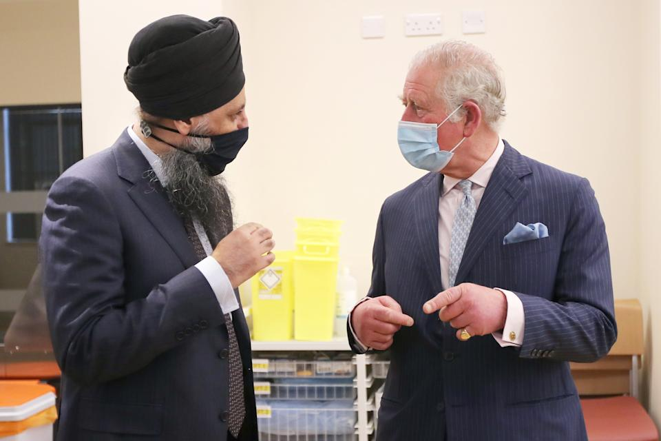 Britain's Prince Charles, Prince of Wales talks with Chief pharmacist Inderjit Singh during a visit to the Queen Elizabeth Hospital in Birmingham, northern England on February 17, 2021. (Photo by MOLLY DARLINGTON / POOL / AFP) (Photo by MOLLY DARLINGTON/POOL/AFP via Getty Images)