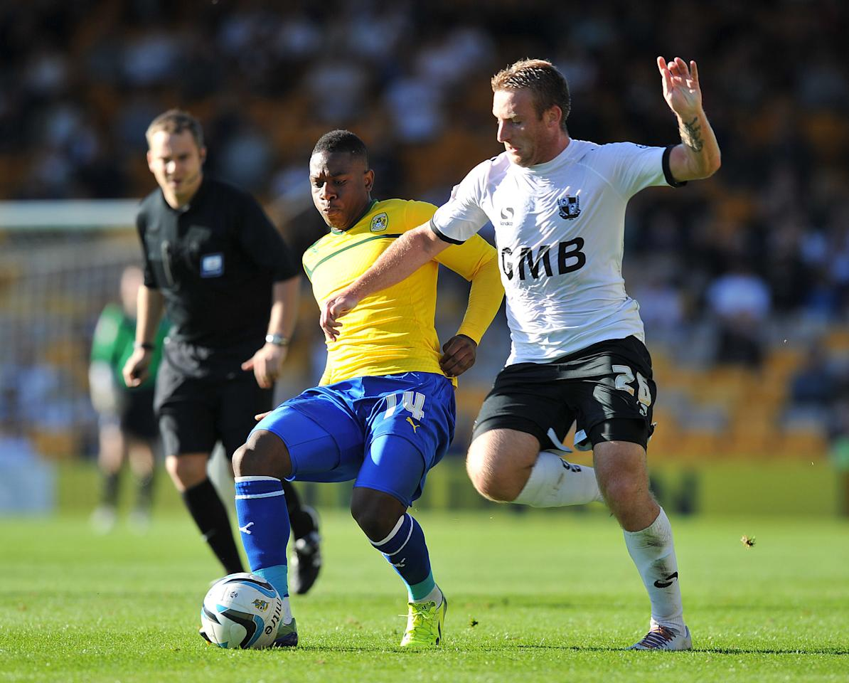 Coventry City's Franck Moussa (left) battles with Port Vale's Chris Birchall (right) during the Sky Bet League One match at Vale Park, Stoke.