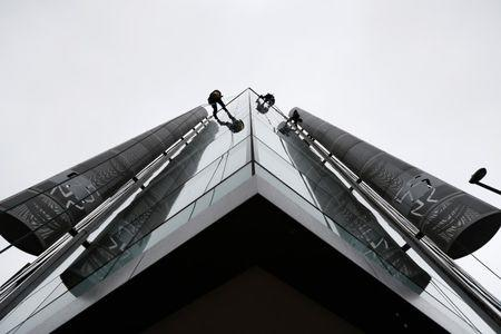 FILE PHOTO: Window cleaners work outside the offices of Cambridge Analytica in central London, Britain, March 24, 2018. REUTERS/Peter Nicholls
