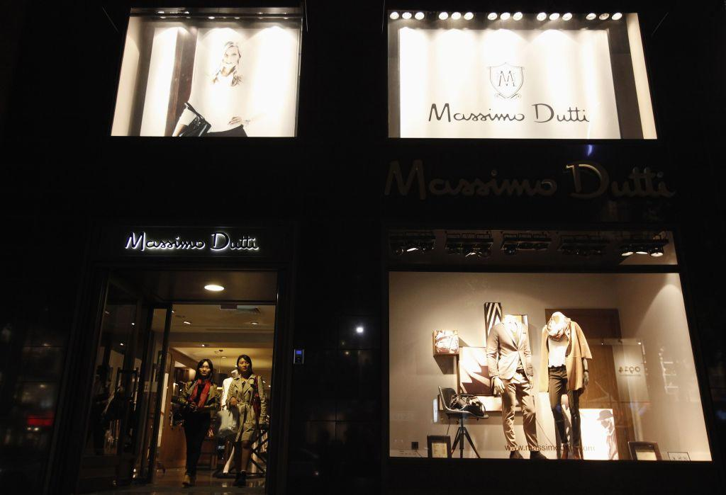 Women walk out of a Massimo Dutti clothes store on the Garosugil or the Tree-Lined Street in the Gangnam area of Seoul.