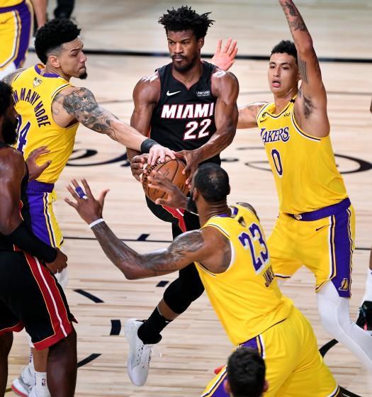 Lakers guard Danny Green, left, knocks the ball from Heat forward Jimmy Butler during Game 1.