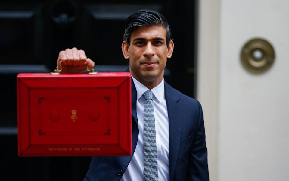 Chancellor Rishi Sunak departs from number 11 Downing Street with his Budget box