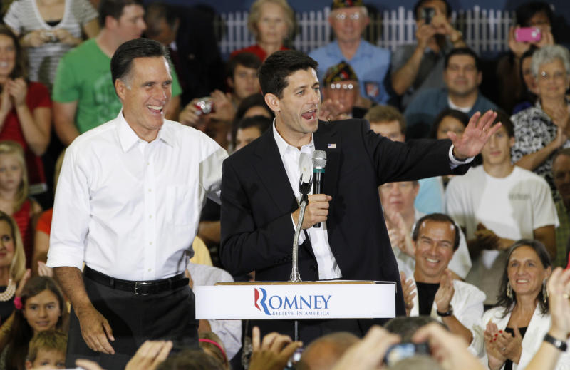 Republican Presidential candidate, Mitt Romney, left , and his running mate, Rep. Paul Ryan, R-Wis. wave to the crowd as they arrive for a rally at Randolph-Macon College in Ashland, Va., Saturday, Aug. 11, 2012. ( AP Photo/Steve Helber)