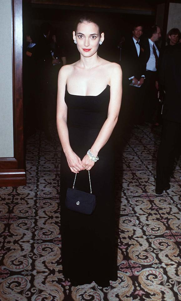 """<p>Ryder's dress from 1996 combined a scooping neckline with a strapless silhouette for something totally unique. These days, <a href=""""https://www.popsugar.com/fashion/Meghan-Markle-Dress-Style-Neckline-45170966"""" class=""""ga-track"""" data-ga-category=""""Related"""" data-ga-label=""""http://www.popsugar.com/fashion/Meghan-Markle-Dress-Style-Neckline-45170966"""" data-ga-action=""""In-Line Links"""">unusual necklines</a> are making a comeback, getting us out of the rut of the same three or four styles.</p>"""
