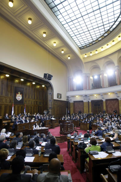 Members of the Serbian parliament convene prior to voting on the new government in Belgrade, Serbia, Thursday, July 26, 2012. Wartime spokesman of late strongman Slobodan Milosevic, who has shifted away from the former patron but has also kept some of his trademark features, is set to become Serbia's new prime minister on Thursday, triggering unease despite his proclaimed pro-EU policies. (AP Photo/ Marko Drobnjakovic)