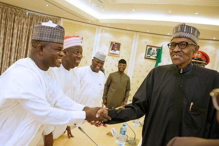 Nigeria's President Muhammadu Buhari, returning from a medical trip from London, is welcomed by governors in Abuja
