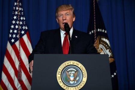 U.S. President Donald Trump delivers an statement about missile strikes on a Syrian airbase, at his Mar-a-Lago estate in West Palm Beach