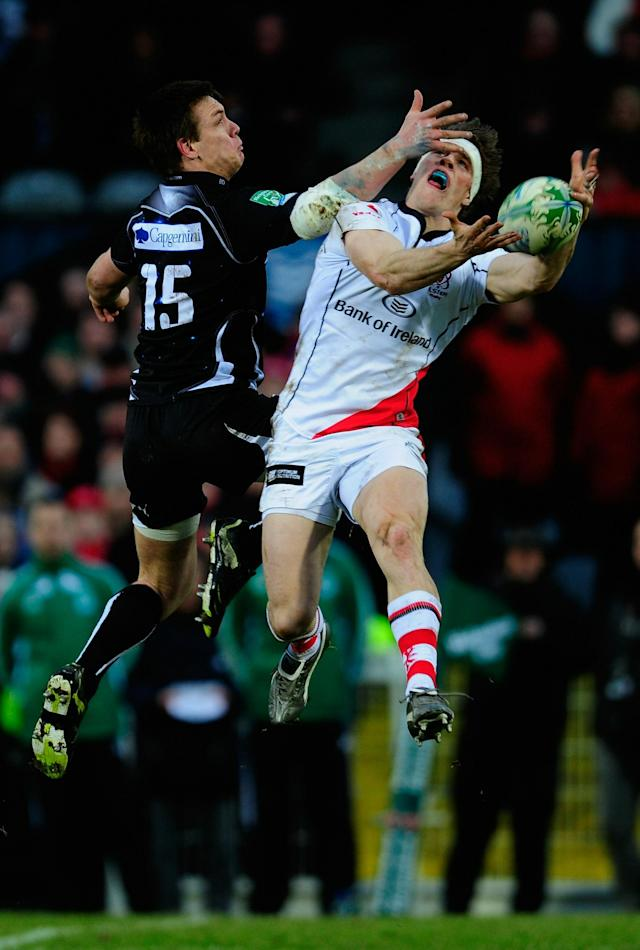 BELFAST, NORTHERN IRELAND - JANUARY 15: Adam D'Arcy of Ulster jumps for a high ball with Dane Haylett-Petty of Biarritz during the Heineken Cup match between Ulster and Biarritz at Ravenhill on January 15, 2011 in Belfast, Northern Ireland. (Photo by Jamie McDonald/Getty Images)