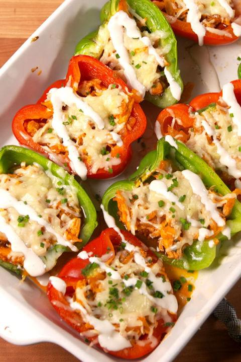 """<p>Spice up your stuffed pepper game!</p><p>Get the recipe from<a rel=""""nofollow"""" href=""""http://www.delish.com/cooking/recipe-ideas/recipes/a51994/buffalo-chicken-stuffed-peppers-recipes/"""">Delish</a>.</p>"""