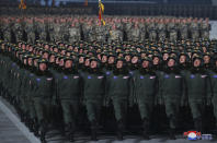 "In this photo provided by the North Korean government, North Korean soldiers march in formation during a military parade marking the ruling party congress, at Kim Il Sung Square in Pyongyang, North Korea Thursday, Jan. 14, 2021. North Korea rolled out developmental ballistic missiles designed to be launched from submarines and other military hardware in a parade that punctuated leader Kim Jong Un's defiant calls to expand his nuclear weapons program. Independent journalists were not given access to cover the event depicted in this image distributed by the North Korean government. The content of this image is as provided and cannot be independently verified. Korean language watermark on image as provided by source reads: ""KCNA"" which is the abbreviation for Korean Central News Agency. (Korean Central News Agency/Korea News Service via AP)"