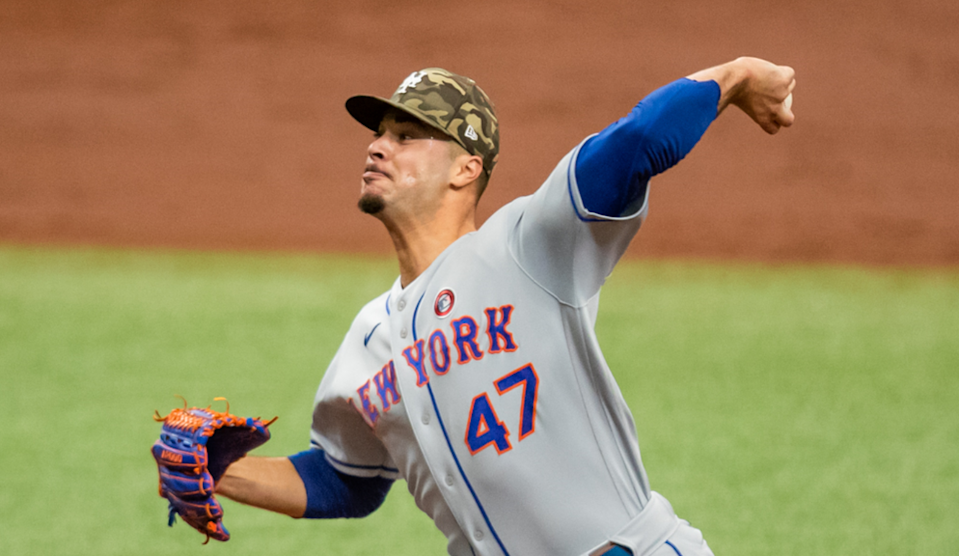 May 15, 2021; St. Petersburg, Florida, USA; New York Mets relief pitcher Joey Lucchesi (47) delivers a pitch during the fourth inning of a game against the Tampa Bay Rays at Tropicana Field. Mandatory Credit: Mary Holt-USA TODAY Sports