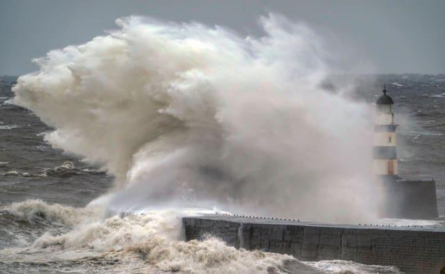 Huge waves crash over Seaham lighthouse in Co Durham
