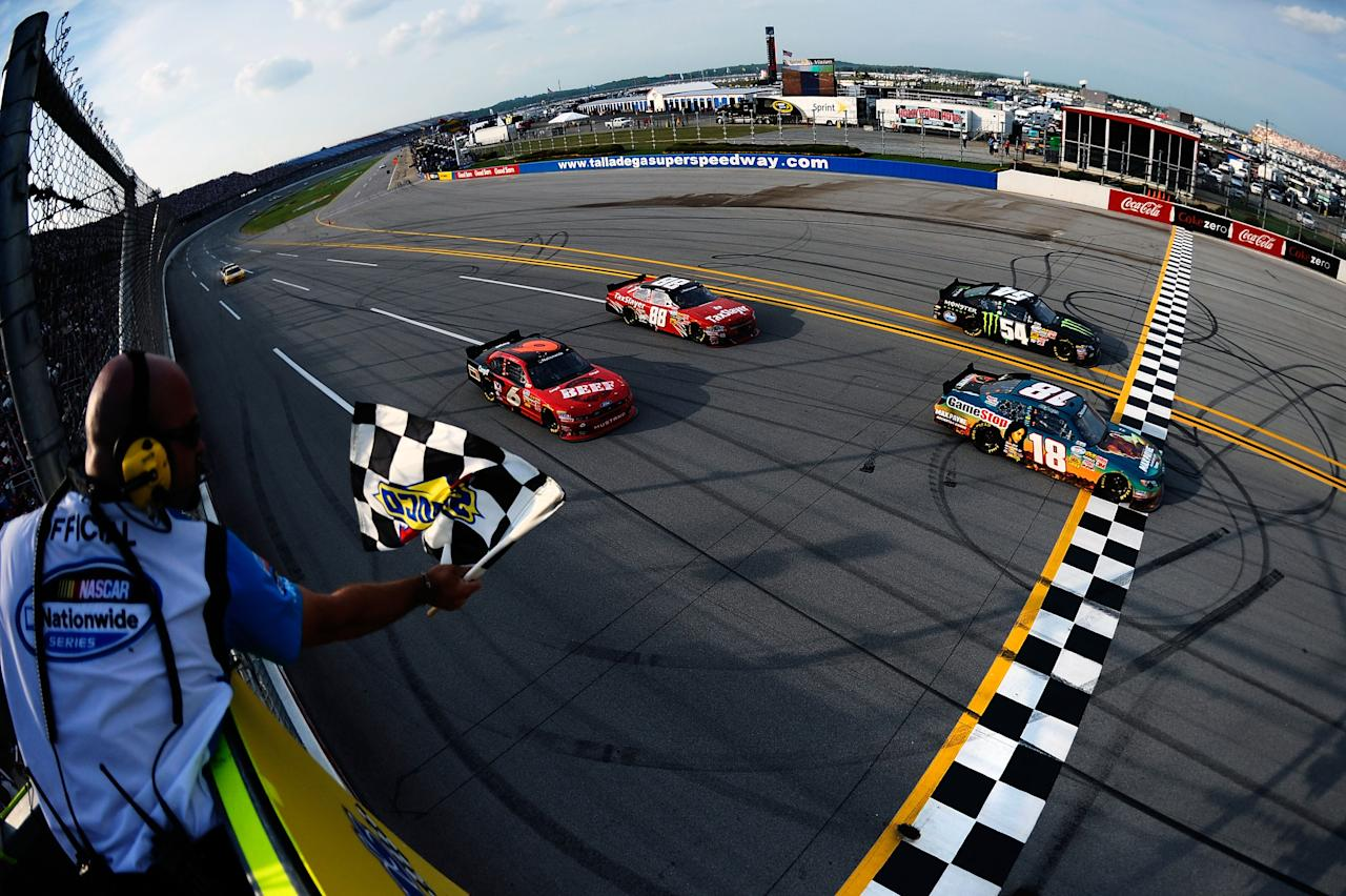 TALLADEGA, AL - MAY 05:  Joey Logano, driver of the #18 GameStop Toyota, crosses the finish line to win the NASCAR Nationwide Series Aaron's 312 at Talladega Superspeedway on May 5, 2012 in Talladega, Alabama.  (Photo by Jared C. Tilton/Getty Images)