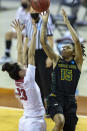 Wright State guard Angel Baker (15) scores over Arkansas guard Amber Ramirez (23) during the first half of a college basketball game in the first round of the women's NCAA tournament at the Frank Erwin Center in Austin, Texas, Monday, March 22, 2021. (AP Photo/Stephen Spillman)