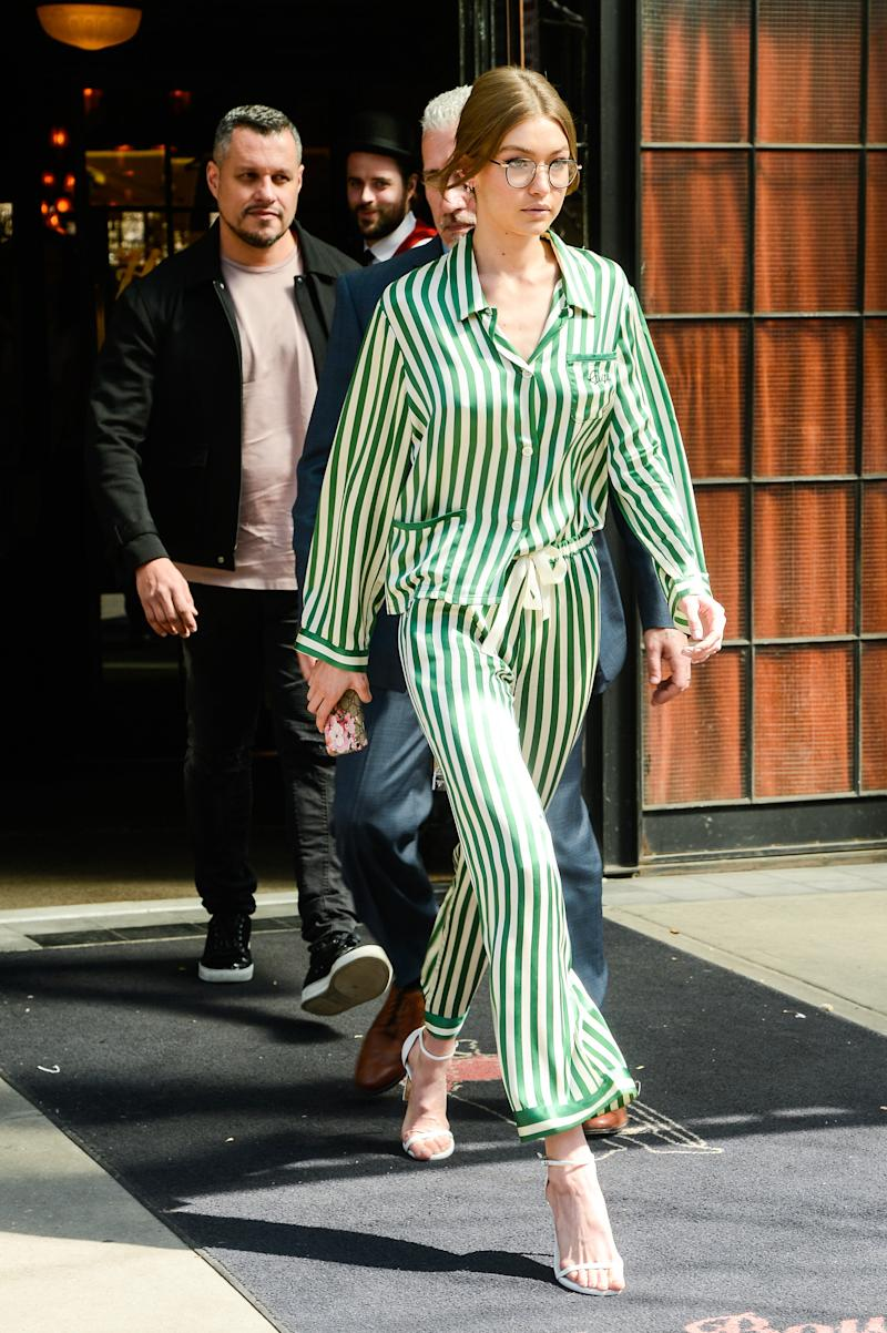 In April, Hadid left a New York City hotel wearing a green PJ set and heeled sandals. (Ray Tamarra via Getty Images)
