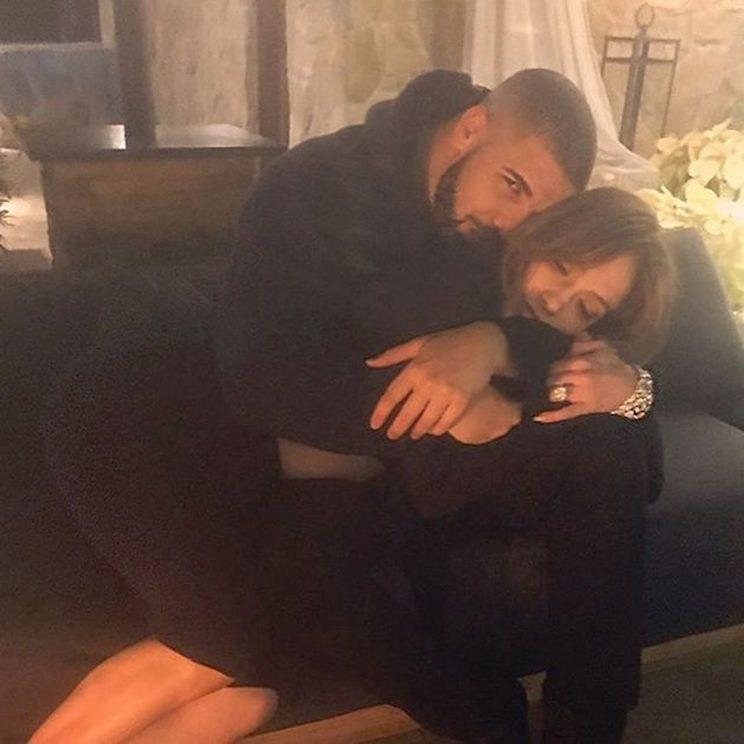 The singer posted this photo of her and Drake doing some serious cuddling simultaneously as he posted the same photo to his account. No captions were on either one as they try to keep fans guessing about exactly what's going on with them. (Photo: Instagram)