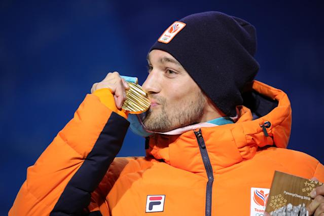 <p>Gold medalist Kjeld Nuis of the Netherlands poses during the medal ceremony for the Men's 1500m speed skating. Fellow Netherlander Patrick Roest took silver while Min Seok Kim of S. Korea took bronze.(Getty) </p>