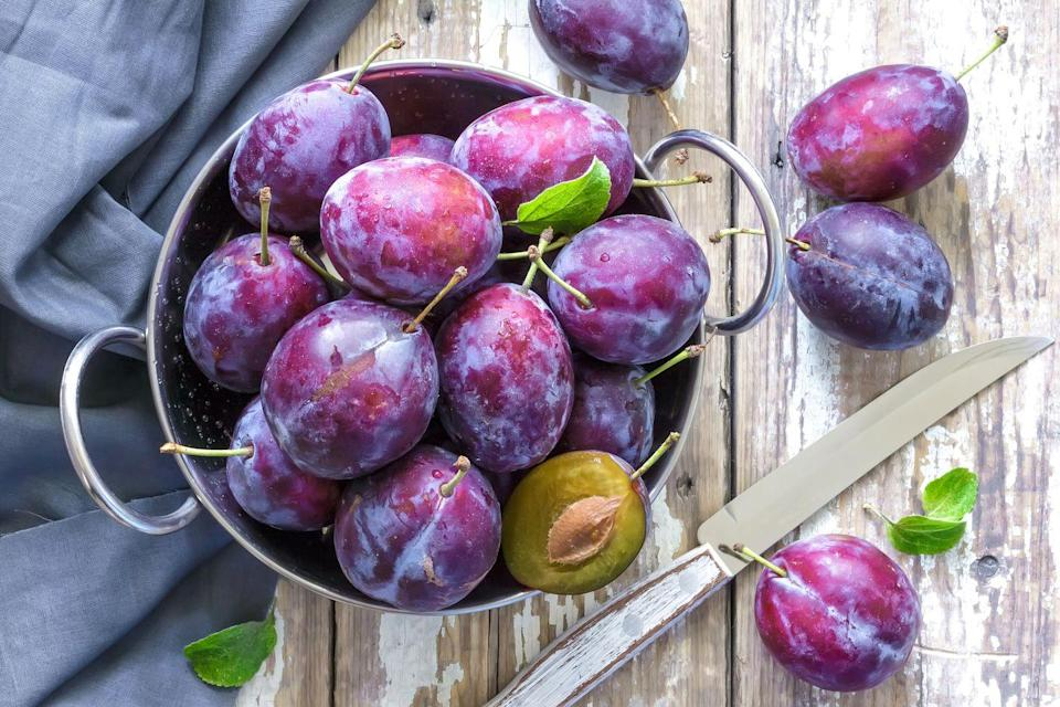 """<p>Dark-hued fruits, such as plums and prunes, are packed with powerful antioxidants that work to fight free-radical damage in the body. </p><p>""""Free radicals in the environment can cause damage to our cells, altering their appearance or function, and can even lead to cancer,"""" warns Roger E. Adams, PhD, a personal trainer and owner of <u><a href=""""https://eatrightfitness.com/"""" rel=""""nofollow noopener"""" target=""""_blank"""" data-ylk=""""slk:eatrightfitness"""" class=""""link rapid-noclick-resp"""">eatrightfitness</a></u>. """"The protective effect of antioxidants can keep cells in the body from degrading as quickly and succumbing to the detrimental effects of aging."""" Chop up some plums and prunes and toss them into a salad or a smoothie for a hint of natural sweetness.</p>"""