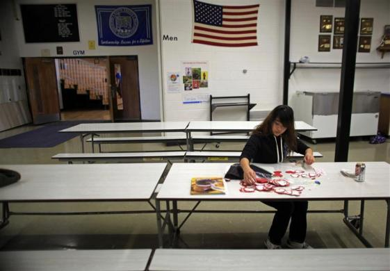 Tina Chuang, a foreign exchange student from Pingtung, Taiwan cuts out paper hearts to use for Valentine's Day presents in the cafeteria at Grant-Deuel School in Revillo, South Dakota February 13, 2012.