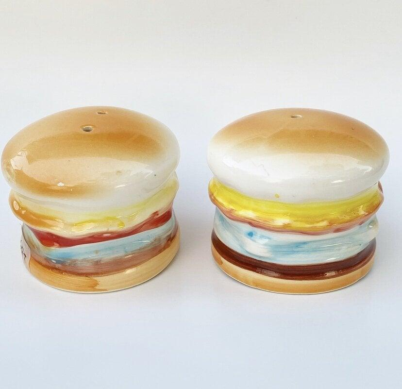<p>Add some character to their kitchen with <span>The Lam Label Burger Salt and Pepper Shakers</span> ($28).</p>
