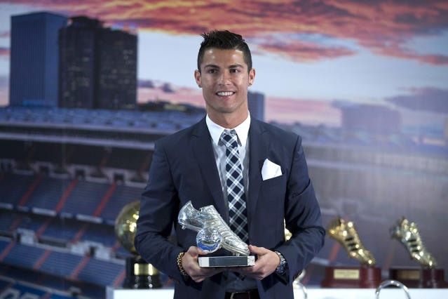 <p>Ronaldo poses for a picture with his trophy as all-time top scorer of of Real Madrid </p>