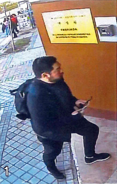 This Feb. 22, 2019 image from surveillance video at the North Korean Embassy to Spain in Madrid, contained in Department of Justice documents presented by federal prosecutors, shows U.S. Marine veteran Christopher Ahn as he prepares to enter the embassy. Ahn, suspected of involvement in a mysterious dissident group's February raid on North Korea's embassy, has been denied bond by a federal judge and must stay in custody. Ahn appeared in a Los Angeles courtroom on Tuesday, April 23. The charges against Ahn haven't been made public. (U.S. Department of Justice via AP)