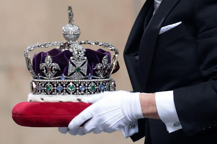 The Imperial State Crown arrives for the State Opening of Parliament at the Houses of Parliament in London on May 11, 2021.