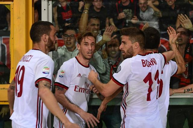 AC Milan players celebrate after Giacomo Bonaventura (Rear R) scored against Torino last week (AFP Photo/MIGUEL MEDINA)