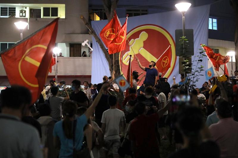 The Workers' Party (WP) supporters in Hougang Ave 5 celebrating after sample counts are announced on 11 July 2020. (PHOTO: Don Wong for Yahoo News Singapore)
