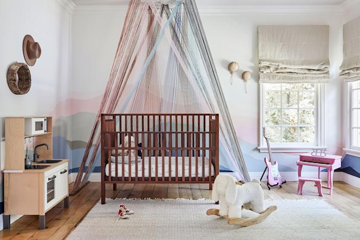 "<div class=""caption""> Duff's daughter Banks's nursery features a pastel mural and string installation by Laura Stewart. ""When I first found out I was having a girl, I thought I was going to be a lot cooler than I was. But then, all of a sudden, it turned into a pink explosion in there,"" says Duff. ""Still, I have tried my best to keep it cool in there because I don't really know <em>who</em> she's going to grow up to be. Picking colors with Laura was a very fun, very collaborative process."" The hat on the wall hangs in anticipation. When a pregnant Duff saw that one of her favorite cowboy hats came in a kids' version, she had to have it: ""I can't wait to be in a magic matching hats with my daughter!"" </div>"