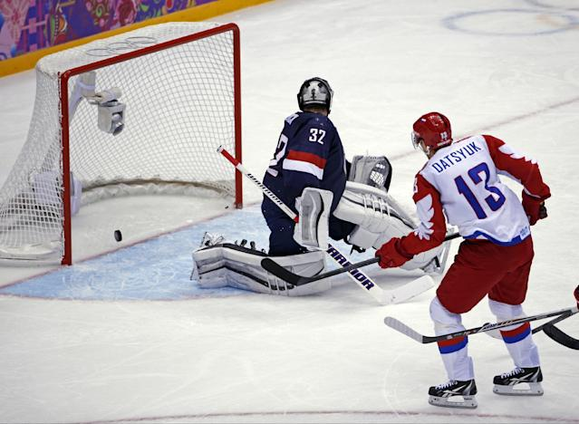 Russia forward Pavel Datsyuk watches his shot cross the goal line for a score against USA goaltender Jonathan Quick in the second period of a men's ice hockey game at the 2014 Winter Olympics, Saturday, Feb. 15, 2014, in Sochi, Russia. (AP Photo/Petr David Josek)
