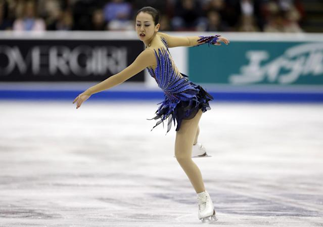 Mao Asada, of Japan, performs during the ladies free skating routine at the Skate America figure skating competition in Detroit, Sunday, Oct. 20, 2013. (AP Photo/Carlos Osorio)