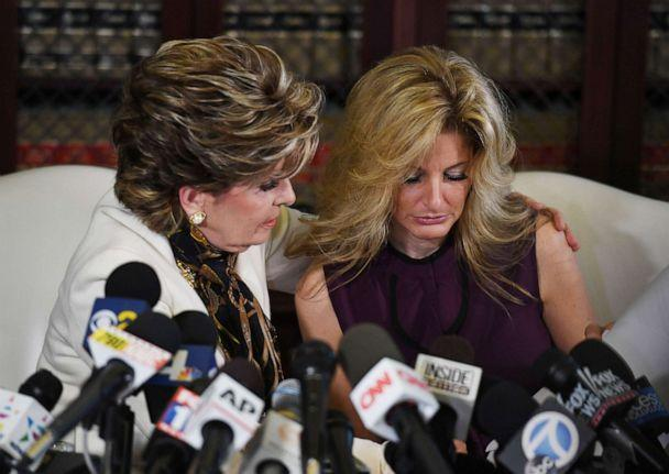 PHOTO: Summer Zervos, right, who was a contestant on the TV show 'The Apprentice,' is comforted by attorney Gloria Allred after she made allegations of sexual misconduct against Donald Trump during a press conference in Los Angeles, Oct. 14, 2016. (Mark Ralston/AFP via Getty Images, FILE)
