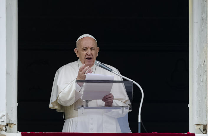 """FILE - In this June 6, 2021 file photo, Pope Francis speaks from the window of his studio overlooking St. Peter's Square at The Vatican to a crowd of faithful and pilgrims gathered for the Sunday Angelus noon prayer. On Friday, June 11, The Associated Press reported on stories circulating online incorrectly claiming a video shows Pope Francis saying in Italian that """"we are living in the end times."""" (AP Photo/Domenico Stinellis, File)"""